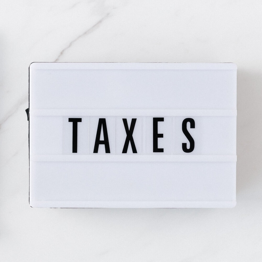 Sign with taxes label