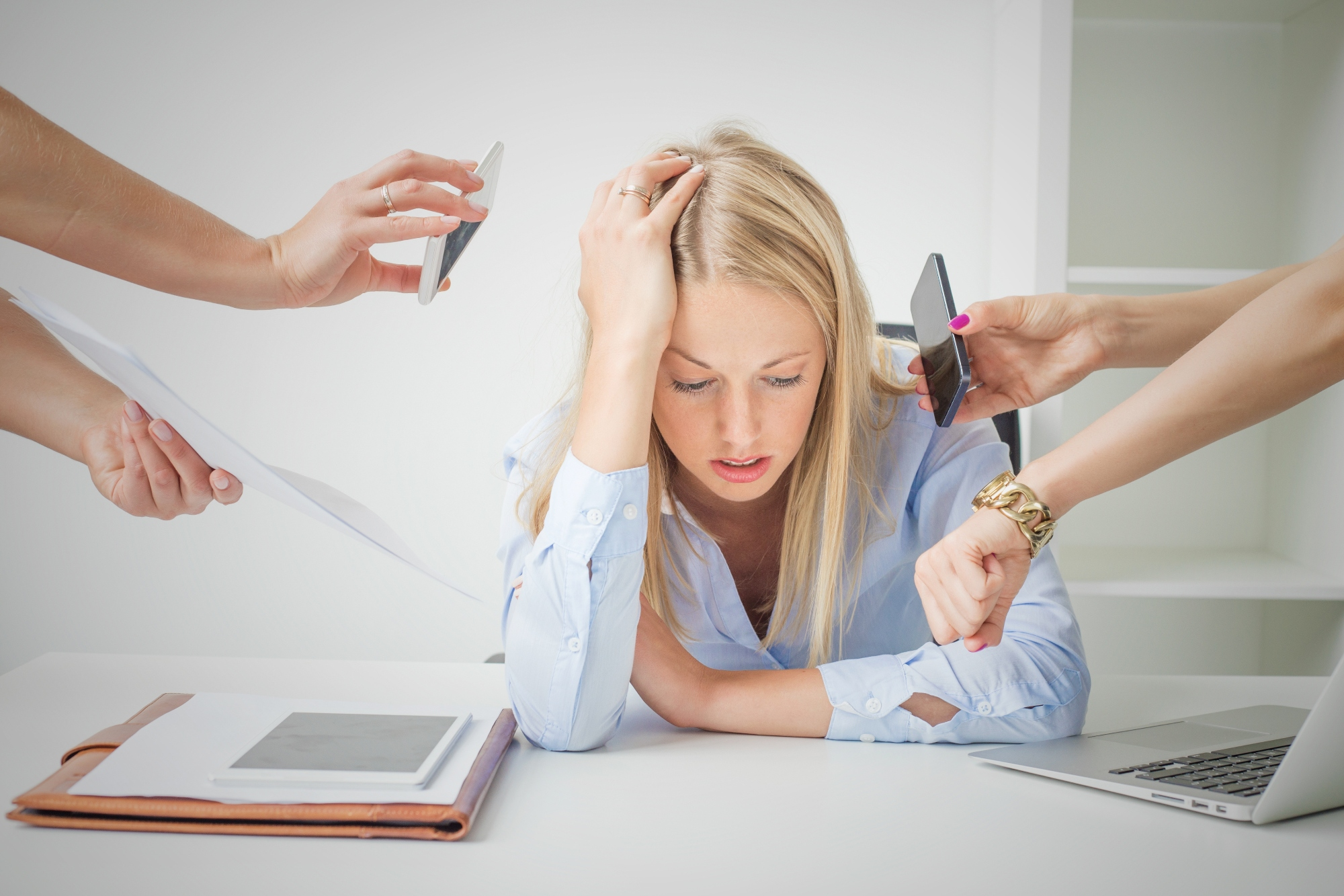 Woman stressed and overworked